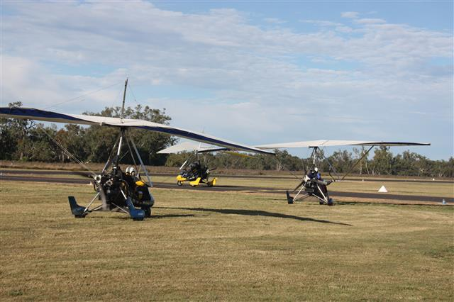 microlight trikes taxiing to take off